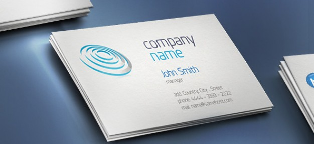 creative business card with company name over blue surface