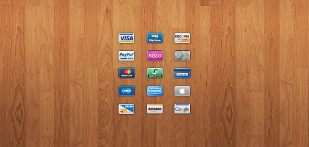 mini cards  of Credit card icons over wood background