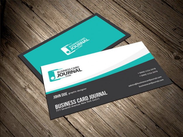 smooth blue flowy creative business card template over vintage wood surface