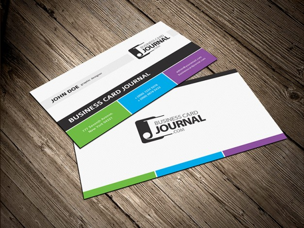 tricolor business card template with three colors bottom over wood surface