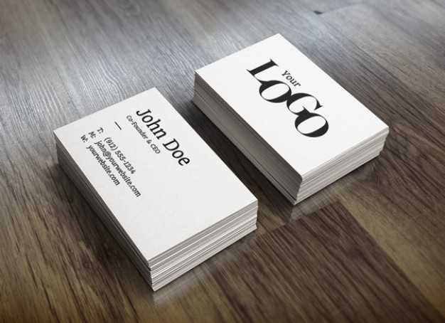 white stack business cards mockup putting on wood table surface