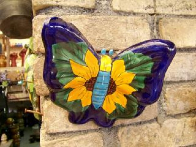 Oaxaca mexican Mexico craft butterfly colour stopping on wall about Alebrije Mitla