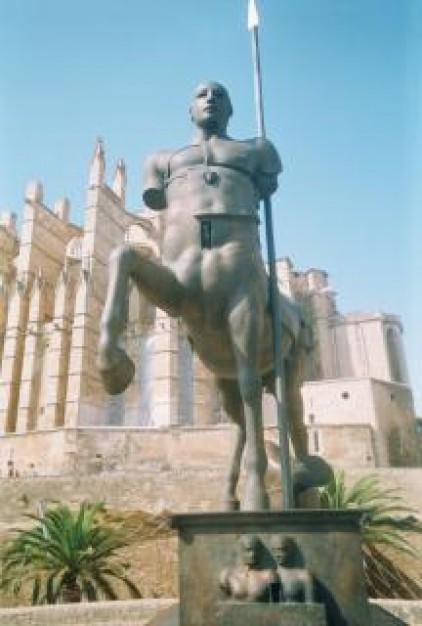 centaur sculpture with structure at back