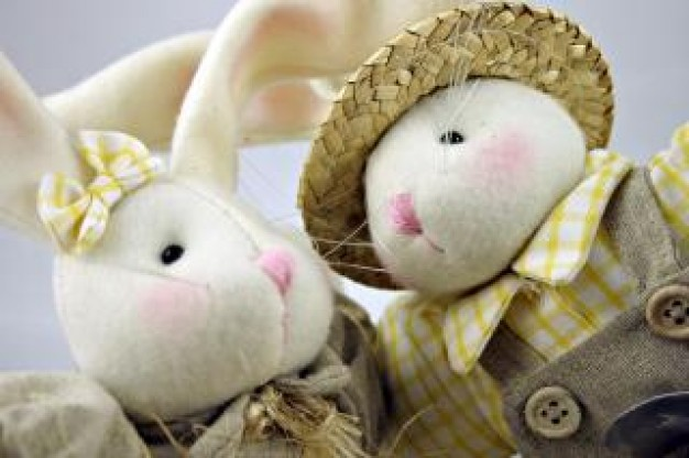 easter rabbits toy with grass hat closeup stuffed