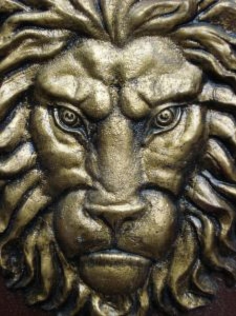forge copper sculpture with powerful lion face