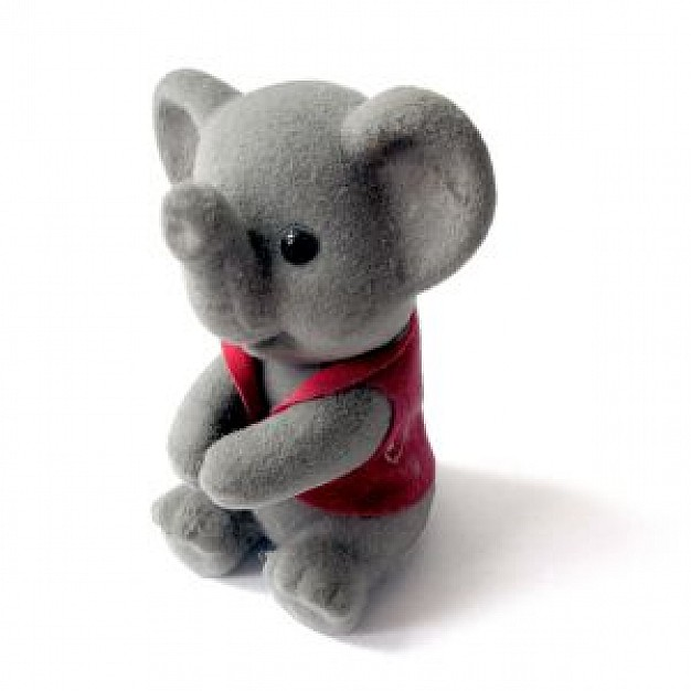 gray elephant toy sitting in white surface