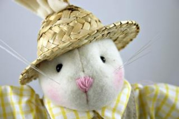 white easter rabbit toy with a grass hat