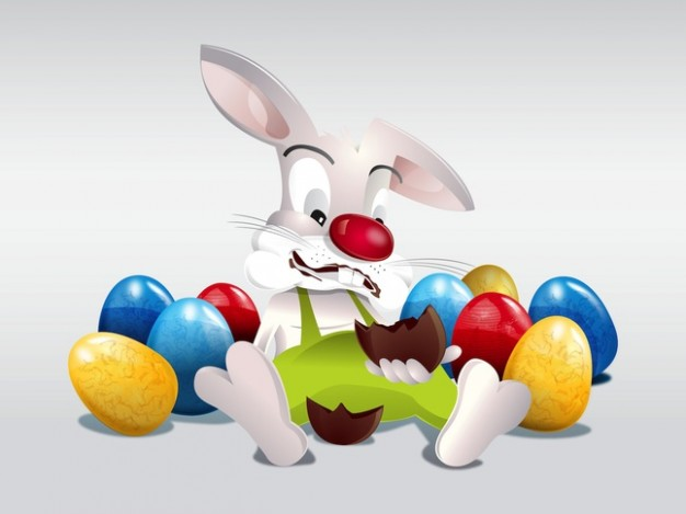 Easter bunny sitting in funny colorful eggs