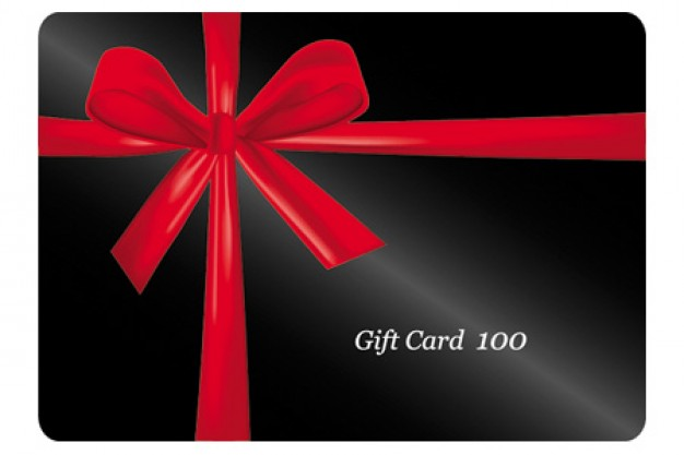 Gift card with red Red ribbon around his black gift cards material about Christmas card