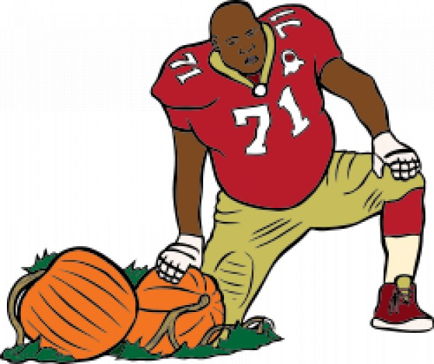 Football Man with red t-shirt standing at side of two pumpkins